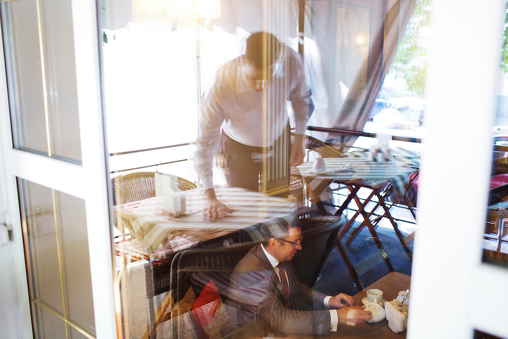 Ivan Mikloš is seen through a window at Gorchitsa Cafe as he is interviewed by a local media outlet on May 25, 2015 in Kyiv, Ukraine. Mr. Mikloš is Chief Advisor to the Minister of Finance of Ukraine and Advisor to the Minister of Economic Development and Trade of Ukraine.