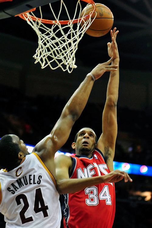 March 23, 2010; Cleveland, OH, USA; New Jersey Nets power forward Brandan Wright (34) shoots over Cleveland Cavaliers power forward Samardo Samuels (24) during the first quarter at Quicken Loans Arena. Mandatory Credit: Jason Miller-US PRESSWIRE