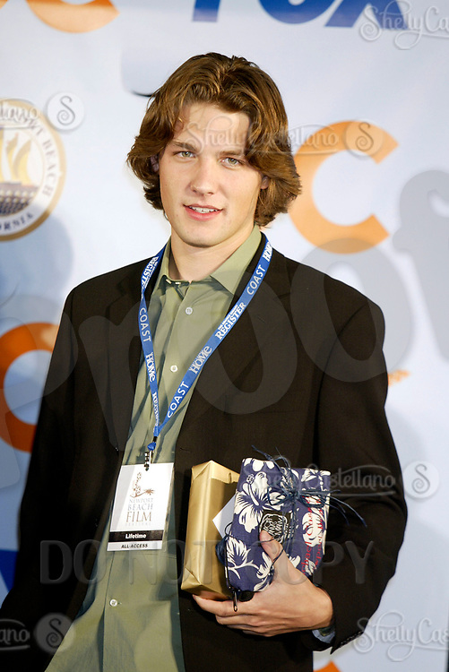 Oct 28, 2004; Newport Beach, CA, USA; Cast Member Michael Cassidy who plays Zach of the FOX hit TV show 'The OC' visited the Balboa Penninsula in Newport Beach to get a Key to the City and be immortalized in cement with thier hand prints to be placed at the enterance to the Historic Balboa Pavillion. Cassidy seen here with lots of free goodies from the ceremony, including a lifetime pass to the Newport Beach Film Festival.  Mandatory Credit: Photo by Shelly Castellano/ZUMA Press.