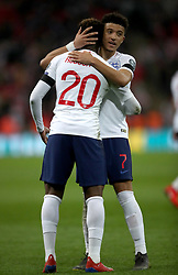 England's Jadon Sancho (right) and Callum Hudson-Odoi embrace after the UEFA Euro 2020 Qualifying, Group A match at Wembley Stadium, London.