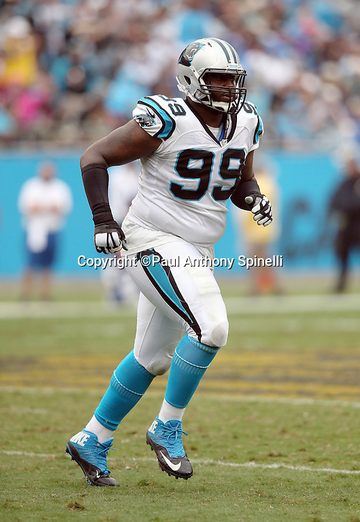 Carolina Panthers defensive tackle Kawann Short (99) jogs cross field during the 2015 NFL week 3 regular season football game against the New Orleans Saints on Sunday, Sept. 27, 2015 in Charlotte, N.C. The Panthers won the game 27-22. (©Paul Anthony Spinelli)