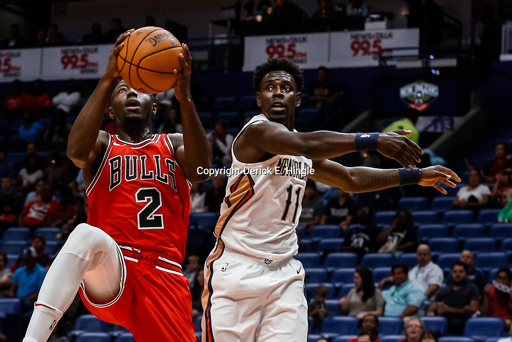 Oct 3, 2017; New Orleans, LA, USA; Chicago Bulls guard Jerian Grant (2) shoots over New Orleans Pelicans guard Jrue Holiday (11) during the first quarter of a NBA preseason game at the Smoothie King Center. Mandatory Credit: Derick E. Hingle-USA TODAY Sports