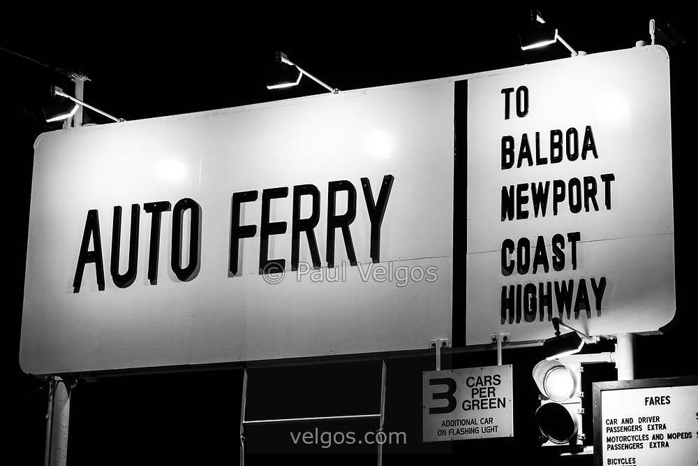 Picture of Auto Ferry Sign to Balboa Peninsula in Newport Beach California. The Balboa Island Ferry transports people and cars across Newport Harbor between Balboa Island and Balboa Peninsula.