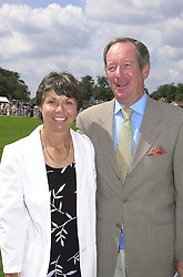 MR & MRS MICHAEL BUERK, he is the news reader, at a polo match in Berkshire on 30th July 2000.OGN 53