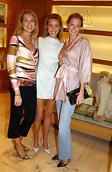 Left to right, MISS ALEX FINLAY, MISS NOELLE RENO and MISS EUGENIE WARRE at a party hosted by Burberry to launch their special collection in aid of Breakthrough Breast Cancer, held at 21-23 New Bond Street, London W1 on 5th October 2004.<br />