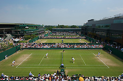 LONDON, ENGLAND - Saturday, June 26, 2010: A general view of court 14 as Colin Fleming (GBR) & Kenneth Skupski (GBR) take on Arnaud Clement (FRA) & Nicolas Mahut (FRA) during the Gentlemen's Doubles 1st Round match on day six of the Wimbledon Lawn Tennis Championships at the All England Lawn Tennis and Croquet Club. (Pic by David Rawcliffe/Propaganda)