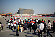 Gugong (Forbidden City, Imperial Palace). Chinese tour group with red caps visiting. Restauration works at Taihe Dian (Hall of Supreme Harmony).