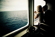Students on the bridge of the MV Explorer in the north Pacific Ocean.