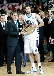 © Licensed to London News Pictures. 12/05/2013. London, UK.  Felipe Reyes of Real Madrid collects the 2nd Place Trophy after his team loses to Olympiacos Piraeus in the final of the Euroleague Basketball Final Four at The O2 Arena.   The Turkish Airlines Euroleague, commonly known as the Euroleague, is the highest level tier and most important professional club basketball competition in Europe, with teams from up to 18 different countries, members of FIBA Europe. Photo credit : Richard Isaac/LNP