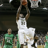 Central Florida guard/forward Isaiah Sykes (32) scores as Marshall guard Shaquille Johnson (23) watches during a Conference USA NCAA basketball game between the Marshall Thundering Herd and the Central Florida Knights at the UCF Arena on January 5, 2011 in Orlando, Florida. Central Florida won the game 65-58 and extended their record to 14-0.  (AP Photo/Alex Menendez)