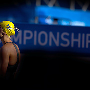 Sarah Sjostrom, Sweden, is caught by the late afternoon Roman light as she waits at the starting blocks for the start of the Women' 100m Butterfly. She went on the break the World Record and win gold. Photo Tim Clayton