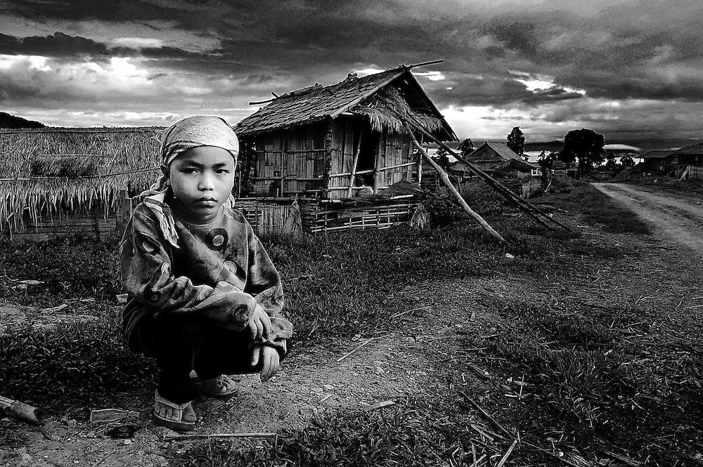 A farm boy ready to begin work in Hongsa, Laos.