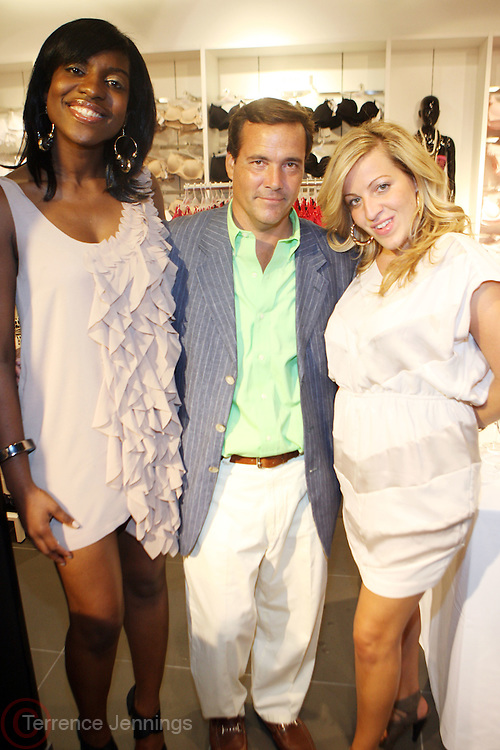 29 July 2010-New York, NY- l to r: Nicole Christie, John Rollins and at The H&M and Uptown Magazine Celebration of the grand re-opening of the H&M Harlem Store with a VIP preview with music, food and 25% off the evenings purchases held at H&M harlem on July 29, 2010 in Harlem, New York City. Photo Credit: Terrence Jennings