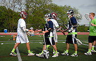 7 MAY 2009 -- CREVE COEUR, Mo. -- Lacrosse players from DeSmet Jesuit High School and St. Louis University High School greet each other at mid-field following the 7th annual Father Marco Cup at DeSmet in Creve Coeur, Mo. Saturday, May 7, 2011. SLUH topped DeSmet 13-10 in the annual game. Image © copyright 2011 Sid Hastings.