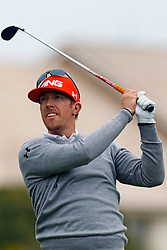 Feb 12, 2012; Pebble Beach CA, USA; Hunter Mahan hits his tee shot on the first hole during the final round of the AT&T Pebble Beach Pro-Am at Pebble Beach Golf Links. Mandatory Credit: Jason O. Watson-US PRESSWIRE