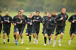 CARDIFF, WALES - Monday, October 13, 2008: Wales' players training at the Vale of Glamorgan Hotel ahead of the 2010 FIFA World Cup South Africa Qualifying Group 4 match against Germany. L-R: Craig Bellamy, Simon Davies, Jason Koumas. (Photo by David Rawcliffe/Propaganda)