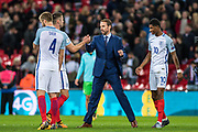 England (5) Gary Cahil, England (4) Eric Dier, England (10) Marcus Rashford and Gareth Southgate after the FIFA World Cup Qualifier match between England and Slovenia at Wembley Stadium, London, England on 5 October 2017. Photo by Sebastian Frej.