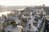 France. Paris. elevated view. Eiffel Tower and Bridge over Seine, The seine river  , Sainte clotilde church bell tower,  the roofs . .