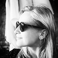 Young Woman in Sunglasses and earrings
