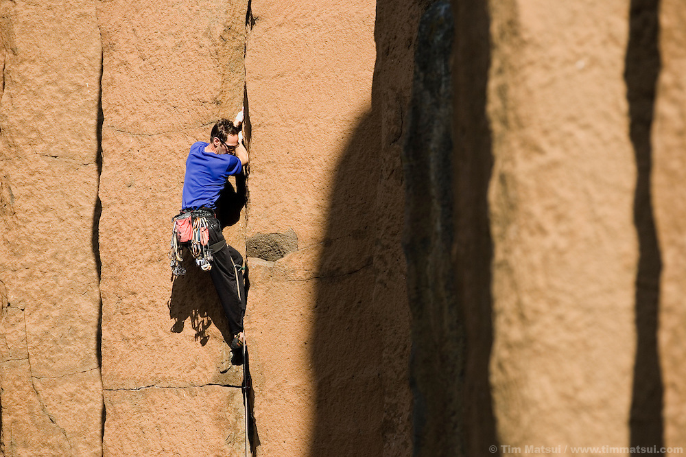 A caucasian mane climbing basalt cracks in Oregon...