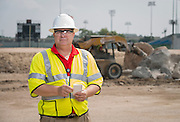John Clark poses for a photograph at the Delmar-Tusa Fieldhouse construction site, July 24, 2014.