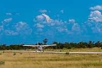 Airplane landing at Kwando Concession, Linyanti Marshes, Botswana.