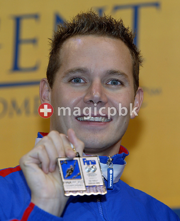 James Hickman of Great Britain shows his silver medal at the medal ceremony of the men's 100m butterfly at the Swimming Short Course World Championships at Conseco Fieldhouse in Indianapolis, Indiana, Friday 8 October 2004. (Photo by Patrick B. Kraemer / MAGICPBK)