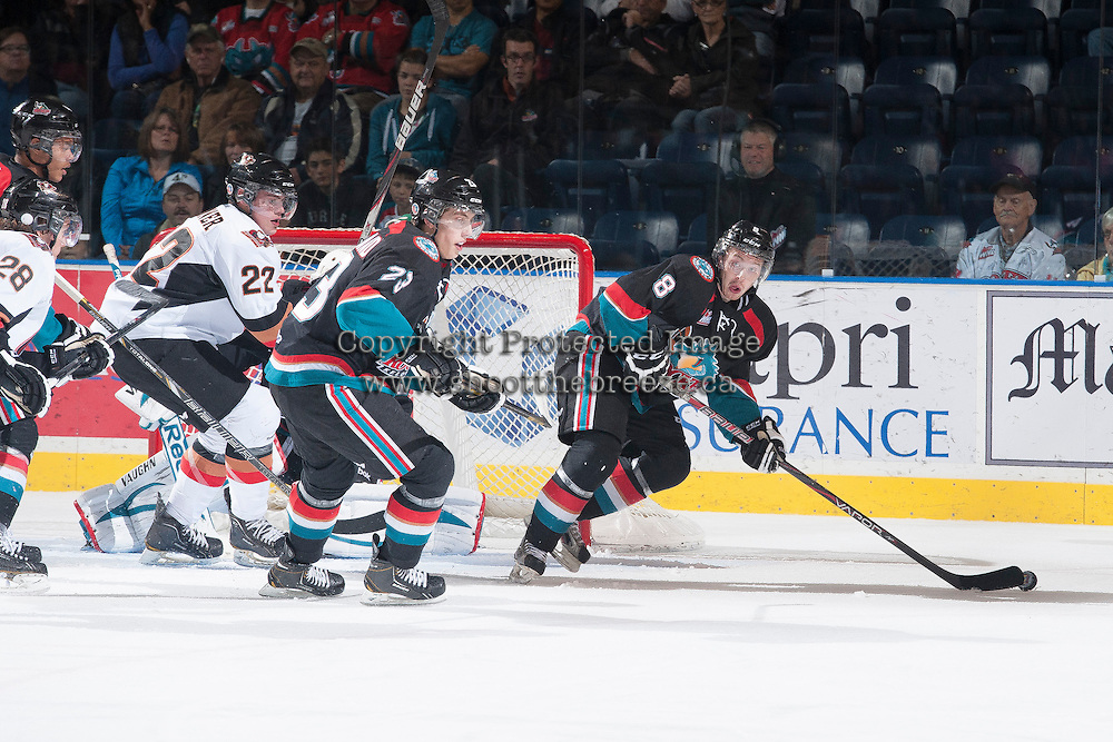 KELOWNA, CANADA - OCTOBER 22: Cole Martin #8 of the Kelowna Rockets skates with the puck against the Calgary Hitmen on October 22, 2013 at Prospera Place in Kelowna, British Columbia, Canada.   (Photo by Marissa Baecker/Shoot the Breeze)  ***  Local Caption  ***
