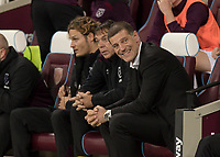 Football - 2017 / 2018 Premier League - West Ham United Vs Huddersfield Town<br /> <br /> An apprehensive looking Slaven Bilic, Manager of West Ham United, gives a nervous smile ahead of kick off at the London Stadium<br /> <br /> COLORSPORT/DANIEL BEARHAM