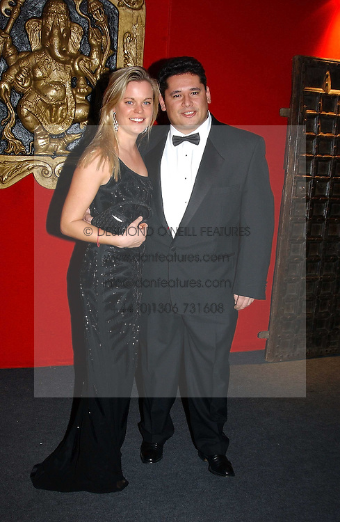 LADY LUCINDA SAVILE and MR PETER D'EUGENIO at the 10th annual British Red Cross London Ball.  This years ball theme was Indian based - &quot;Yaksha - Yakshi: Doorkeepers to the Divine&quot; and was held at The Room, Upper Ground, London on 1st December 2004.  Proceeds from the ball will aid vital humanitarian work, including HIV/AIDS projects that the Red Cross supports in the UK and overseas.<br /><br />NON EXCLUSIVE - WORLD RIGHTS