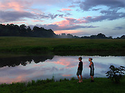 Gary Cosby Jr.  iPhone photographs<br /> Children by a lake at sunset in upstate New York.