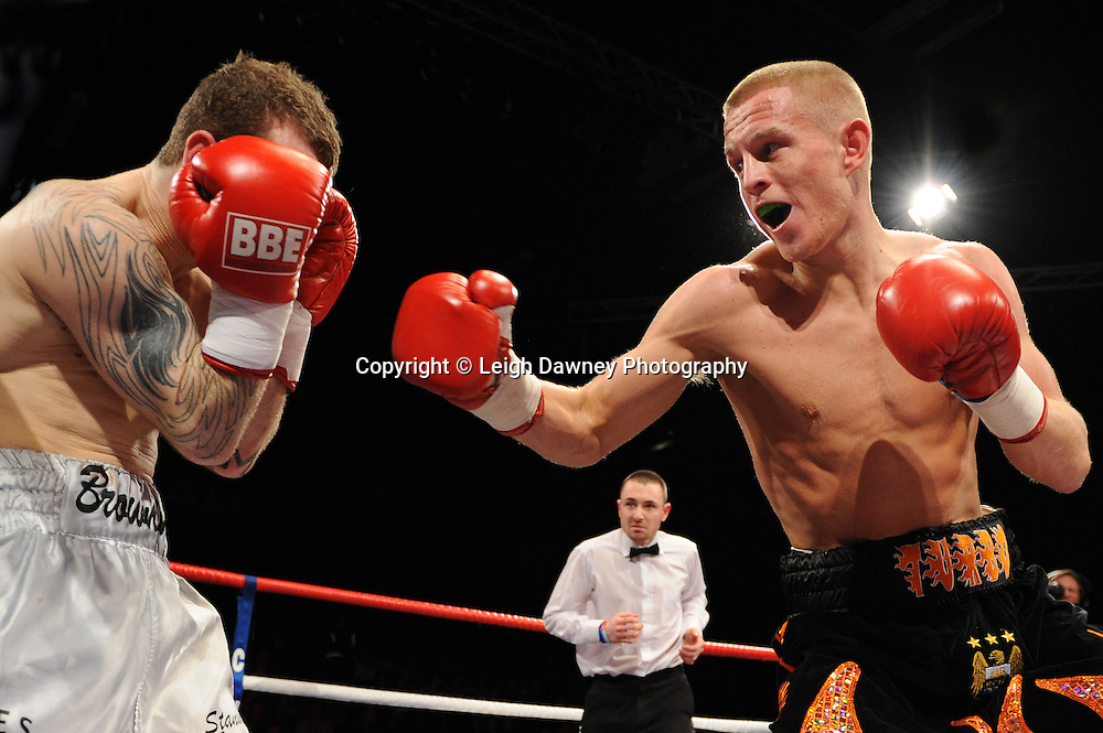 Terry Flannigan (black shorts) defeats Lewis Browning at Brentwood Centre, Brentwood, Essex on the 5th February 2011. Frank Maloney Promotions. Photo credit © Leigh Dawney