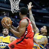18 November 2016: Toronto Raptors guard DeMar DeRozan (10) drives past Denver Nuggets forward Wilson Chandler (21) and Denver Nuggets forward Danilo Gallinari (8) during the Toronto Raptors 113-111 OT victory over the Denver Nuggets, at the Pepsi Center, Denver, Colorado, USA.