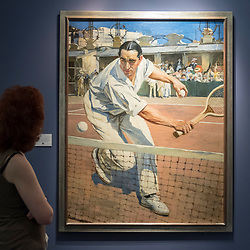 "© Licensed to London News Pictures. 28/06/2018. LONDON, UK. A visitor views ""The French tennis champion, Max Decugis"", 1904, by François Flameng. Members of the public visit Masterpiece London, the world's leading cross-collecting art fair held in the grounds of the Royal Hospital Chelsea.  The fair brings together 160 international exhibitors presenting works from antiquity to the present day and runs 28 June to 4 July 2018.  Photo credit: Stephen Chung/LNP"