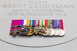 Copies of his medals and his sword lie on the stone as The London Borough of Haringey and representatives of the Armed Forces honour Lieutenant-Colonel Sir Brett Mackay Cloutman VC MC KC with the unveiling of the final London Victoria Cross Commemorative paving stone in Hornsey, London. November 06 2018.