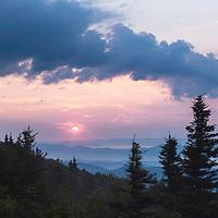 Sun rises over foggy valleys as seen from Bear Rocks