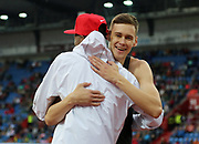 Mutaz Essa Barshim (QAT), left, and Danil Lysenko (RUS) embrace after placing first and second in the hgih jump during the 57th Ostrava Golden Spike track and field meeting in a IAAF World Challenge event at Mestsky Stadium in Ostrava, Czech Republic, Wednesday, June 13, 2018. (Jiro Mochizuki/Image of Sport)