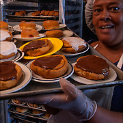 Homeless Soap Kitchen in Atlantic City. Volunteer taking out food. <br />