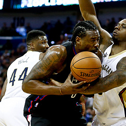 Dec 28, 2016; New Orleans, LA, USA;  Los Angeles Clippers center DeAndre Jordan (6) has the ball knocked away by New Orleans Pelicans forward Terrence Jones (9) during the first quarter of a game at the Smoothie King Center. Mandatory Credit: Derick E. Hingle-USA TODAY Sports