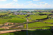 Nederland, Zuid-Holland, Gouda, 15-07-2012; Zuidplaspolder, doorsneden door de A12 en de spoorlijn Gouda - Rotterdam. Lightrail naar Waddinxveen, kassengebied in de polder. Het nu nog overwegend landelijk gebied hoorde oorspronkelijk bij het Groene Hart, maar toekomstplannen voorzien in het verder bebouwen van de polder (vanuit de omliggende steden). .Polderwith railroad and highway crossing each other in the Green Heart of the Netherlands near Gouda..luchtfoto (toeslag), aerial photo (additional fee required).foto/photo Siebe Swa