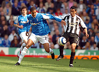 Photo: Leigh Quinnell.<br /> Birmingham City v Newcastle United. The Barclays Premiership. 29/04/2006. Birminghams Julian Gray, batlles with Newcastles Nolberto Solano.