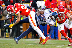 Jan 19, 2020; Kansas City, Missouri, USA; Tennessee Titans tight end Jonnu Smith (81) runs the ball against Kansas City Chiefs strong safety Tyrann Mathieu (32) during the second half in the AFC Championship Game at Arrowhead Stadium. Mandatory Credit: Denny Medley-USA TODAY Sports