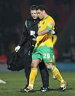 Doncaster - Friday January 30th 2009: Darel Russell of Norwich City is helped from the pitch suffering from a head injury during the Coca Cola Championship Match at The Keepmoat Stadium Doncaster. (Pic by Steven Price/Focus Images)