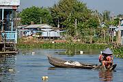 A woman checks her fishing nets at Chau Doc, Vietnam.