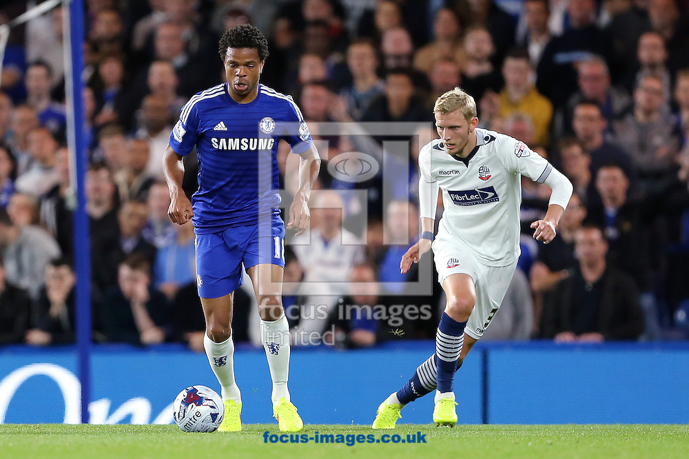 Loic Remy of Chelsea and Dean Moxey of Bolton Wanderers during the Capital One Cup match at Stamford Bridge, London<br /> Picture by Richard Calver/Focus Images Ltd +447792 981244<br /> 24/09/2014