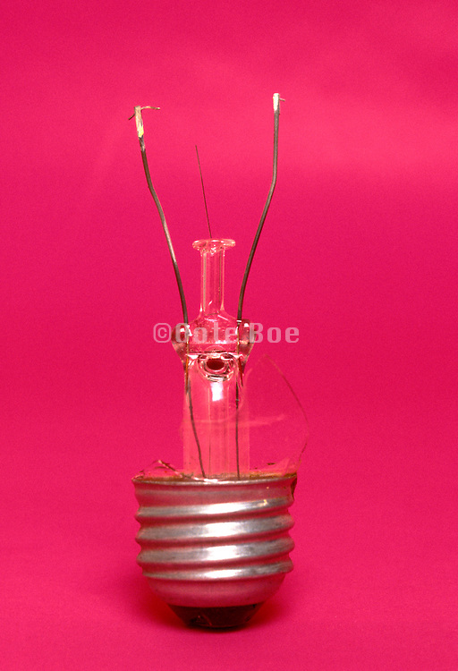 broken light bulb with pink background