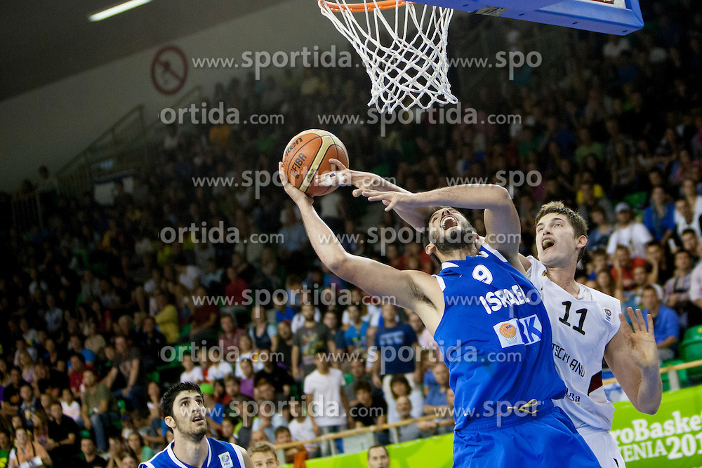 Raviv Limonad #4 of Israel vs Tibor Pleiss #11 of Germany during basketball match between National teams of Germany and Israel at Day 6 of Eurobasket 2013 on September 9, 2013 in Tivoli Hall, Ljubljana, Slovenia. (Photo By Urban Urbanc / Sportida)