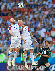 MOSCOW, RUSSIA - Saturday, June 16, 2018: Iceland's Aron Gunnarsson (left) and Emil Hallfredsson (centre) head the ball as Argentina's Maximiliano Meza (right) looks on during the FIFA World Cup Russia 2018 Group D match between Argentina and Iceland at the Spartak Stadium. (Pic by David Rawcliffe/Propaganda)