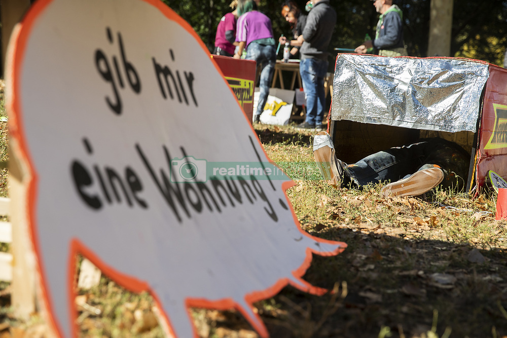 September 30, 2018 - Berlin, Germany - Feet of a sleeping man and a shield reading 'give me an apartment' are seen in a exhibition of urban furniture for homeless people during the 4. Federal Conference for Street Children in Berlin on September 30. 2018. (Credit Image: © Emmanuele Contini/NurPhoto/ZUMA Press)
