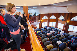 © Licensed to London News Pictures. 05/02/2017. London, UK.  Guests watch a mass pray taking place during an open day at Finsbury Park Mosque in North London.  On Visit My Mosque Day over 150 mosques around the UK open their doors to the public, offering a better understanding of religion in effort to counter rising Islamophobia.  Photo credit: Tolga Akmen/LNP